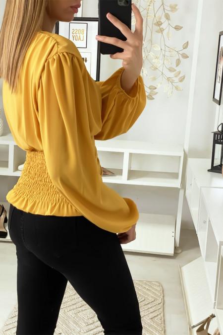 Mosterdgele blouse gekruist bij de buste en cinched in de taille