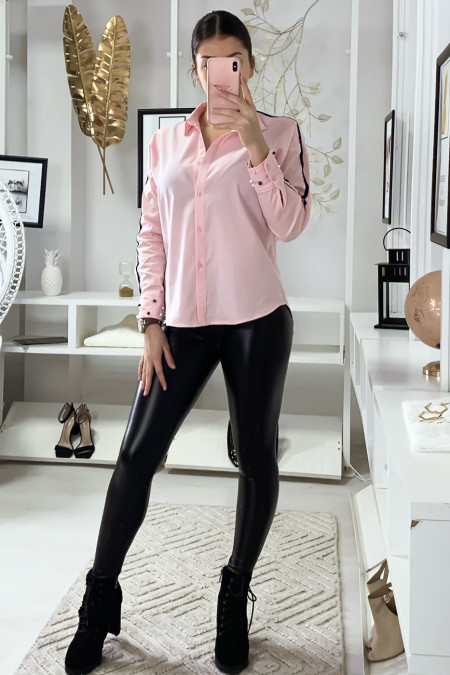 Pink shirt with white band on the arms and pearls on the sleeves