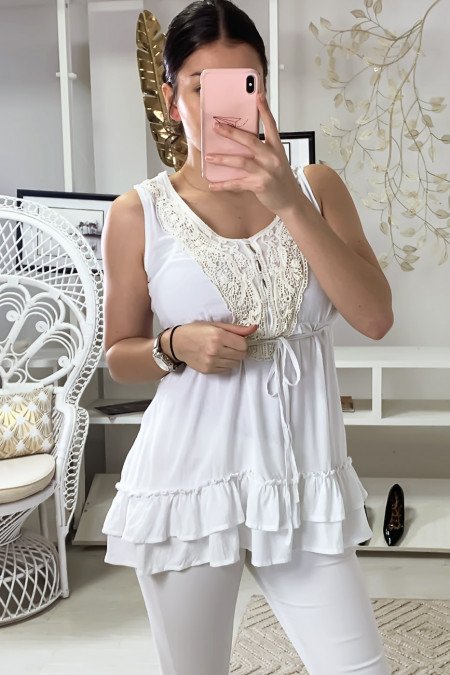 Fluid white top with ruffles and lace on the collar. F1160