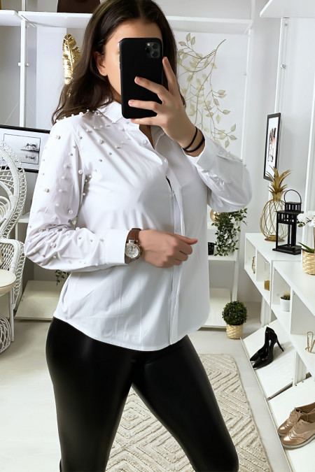 White shirt with pearls on sleeves and shoulders