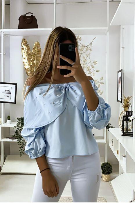 Blauwe blouse met vlinders versierd met strass steentjes aan de voorzijde