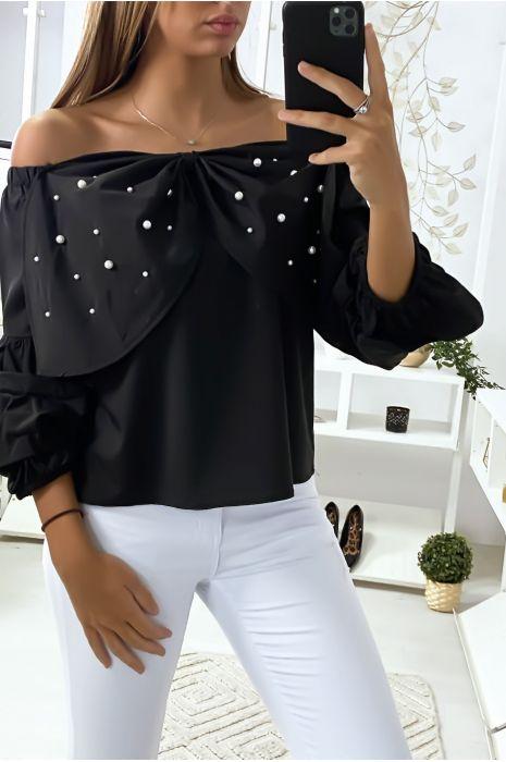 Zwarte blouse met vlinders versierd met strass steentjes aan de voorzijde