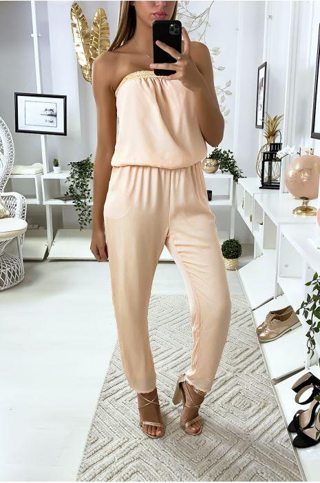 Roze strapless jumpsuit met kant bij de buste en zakken