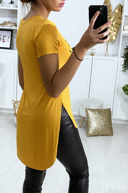 Mustard t-shirt longer at the back with VOGUE writing