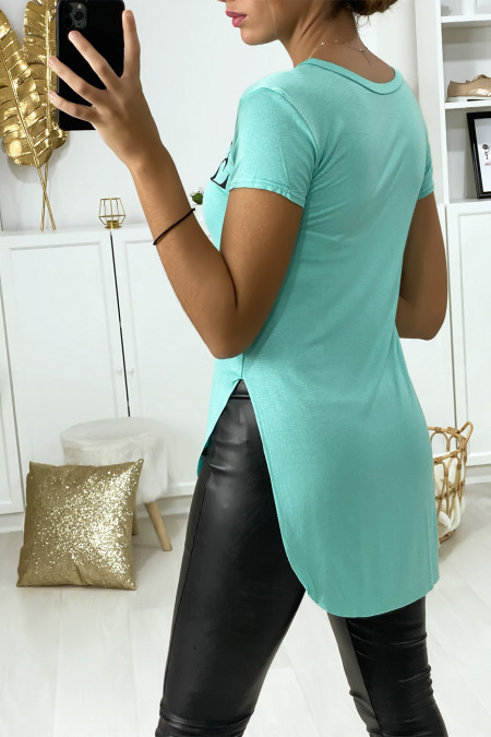 Longer sea green t-shirt at the back with VOGUE writing