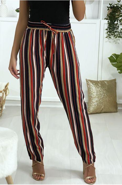 Pantalon à dominance rouge en coton rayé avec poches
