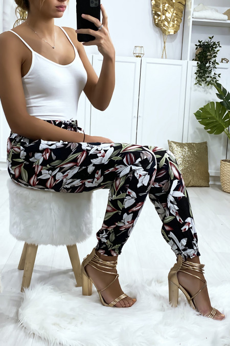 Navy floral pattern trousers, elastic at the ankles with pockets