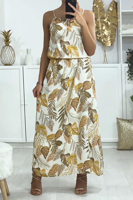 Beige jurk met bladmotief, schouderband en elastiek in de taille