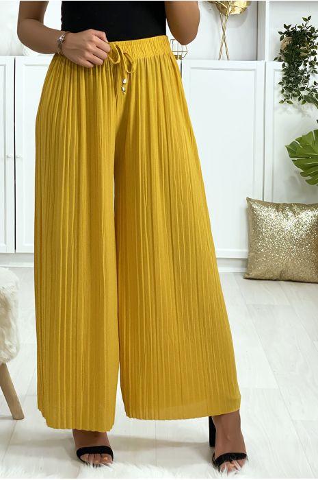 Pantalon palazzo plissé en moutard. Mode femme