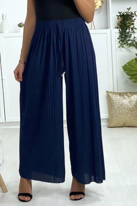 Geplooide palazzo broek in marineblauw. Vrouw mode