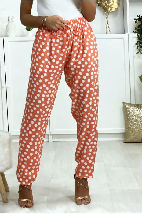 Roze katoenen broek met stippen en zakken. Vrouw mode
