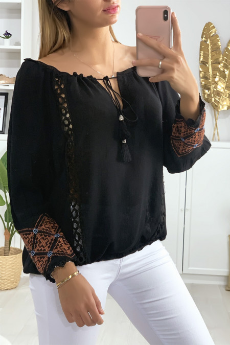 Black blouse with lace at the collar and embroidery on the sleeves
