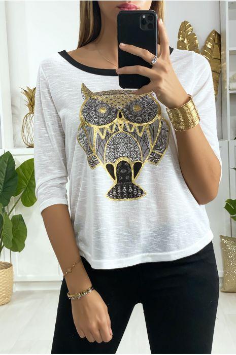 Wit t-shirt met faraonisch motief in goud met strik op de rug