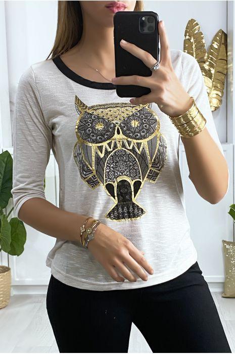 T-shirt beige motif pharaonique en doré avec noeud au dos