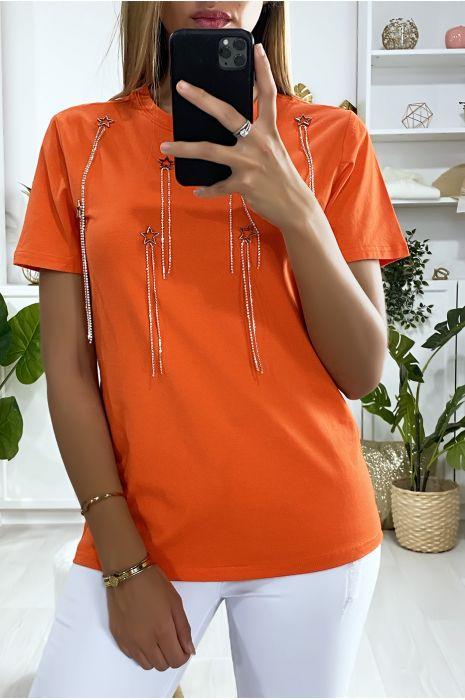 Tee-shirt orange avec accessoire étoiles et strass