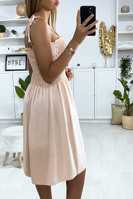 Pink dress with buttoned strap and elastic at the bust