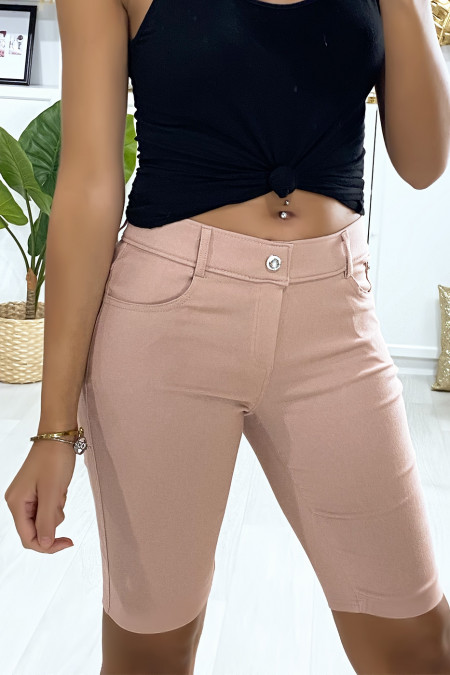 Pink strech shorts with 5 pockets and button with rhinestones