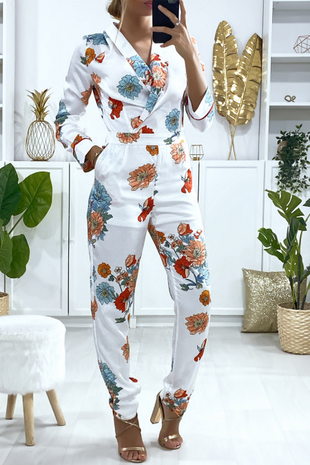 White jumpsuit crossed at the front with floral pattern