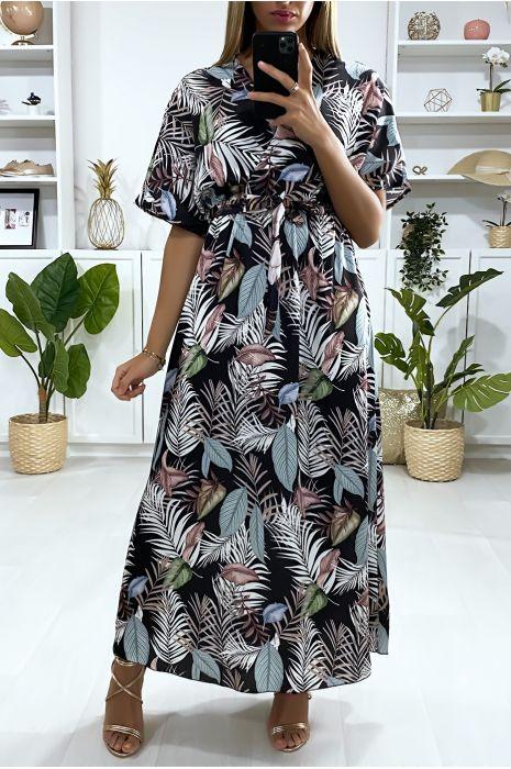 Lange zwarte jurk met bladmotief en gekruiste buste