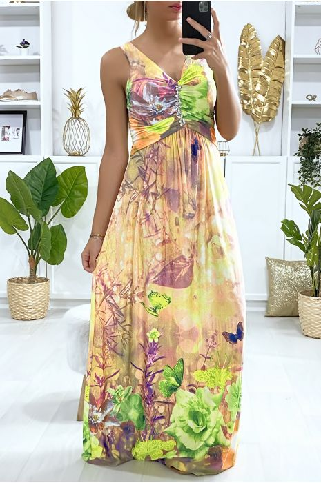 Longue robe motif fleuris jaune avec accessoire au buste