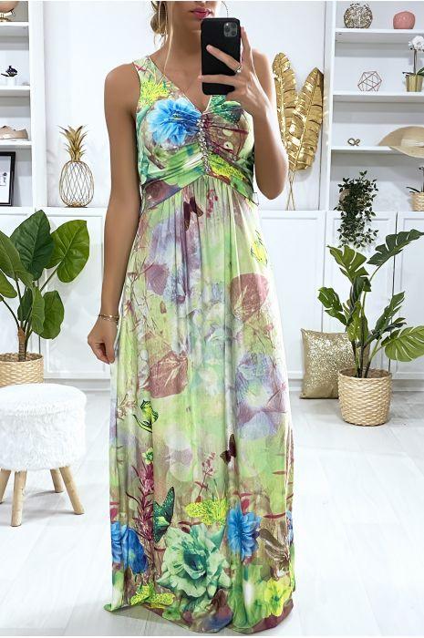 Longue robe motif fleuris vert avec accessoire au buste