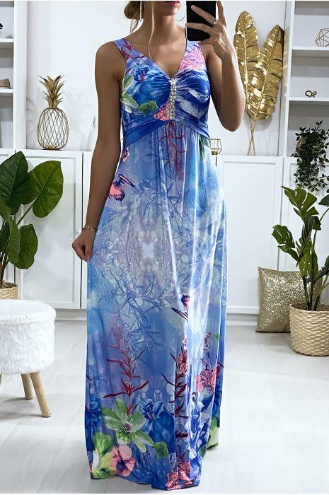 Longue robe motif fleuris bleu avec accessoire au buste