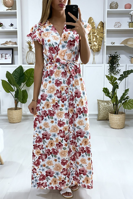 Long white dress with flower pattern crossed at the bust with belt