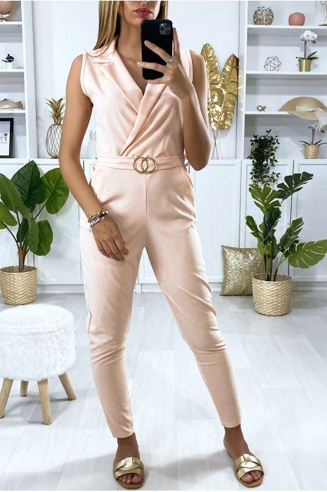 Roze jumpsuit gekruist bij de buste met riem met gesp en zakjes