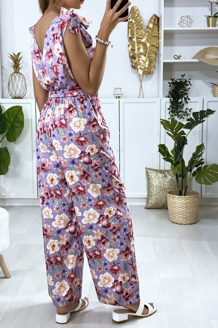 Jumpsuit met lila bloemenpatroon en strik bij de bandjes