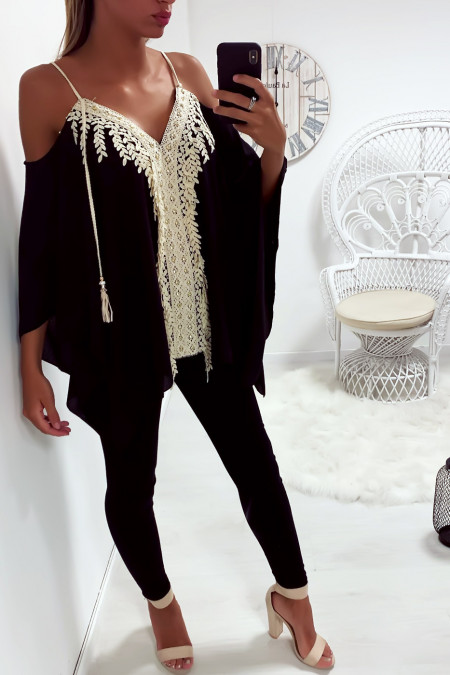 Black batwing strappy blouse adorned with lace and rhinestones
