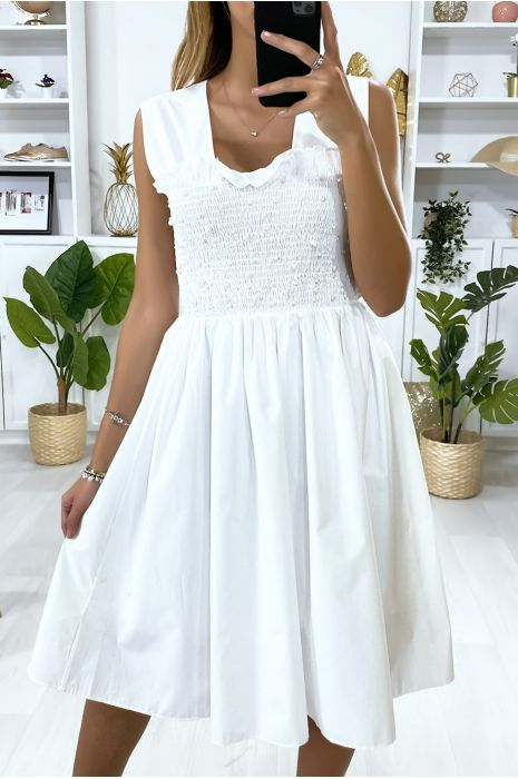 Witte wijd uitlopende jurk met parels en elastiek bij de buste