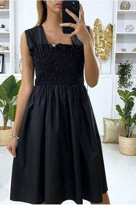 Uitlopende zwarte jurk met parels en elastiek bij de buste