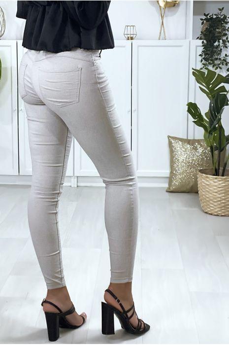 Pantalon slim en gris avec poches forme push up à l'arrière
