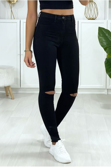 Zwarte skinny jeans met gescheurde knieën en achterzakken