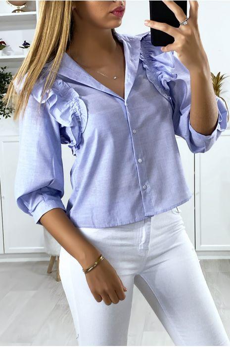 Blauw overhemd met franjes op de schouders