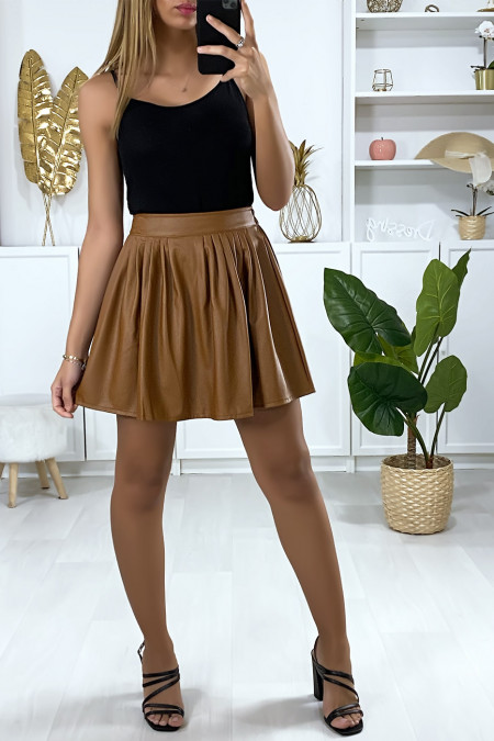 Mini flared skirt in faux camel with pleats at the waist