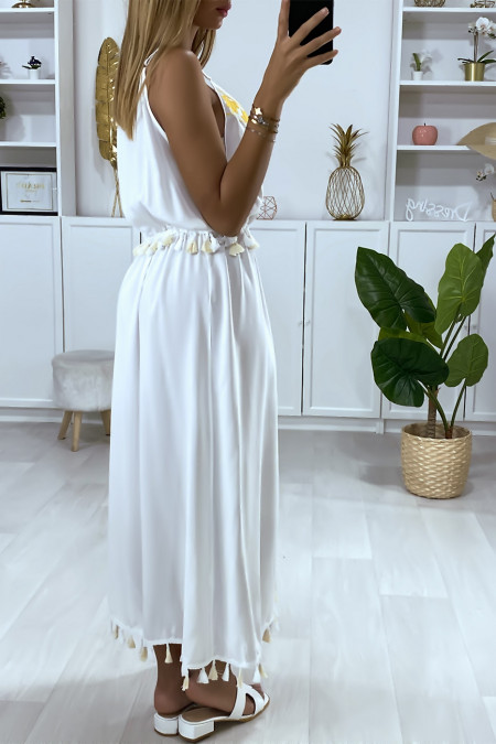 Long white dress with yellow embroidery and pompom