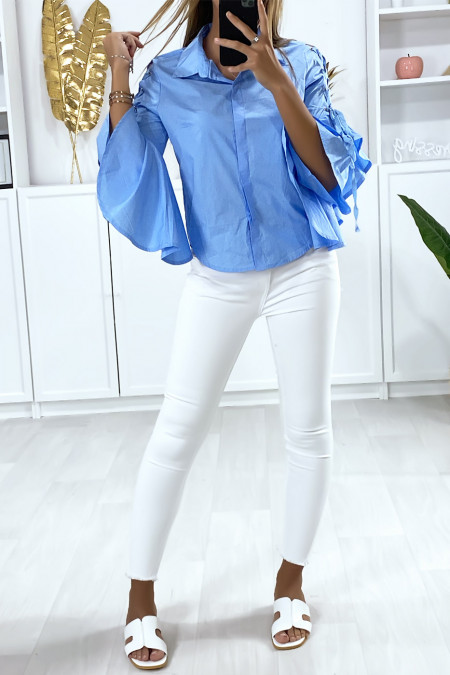 Blue shirt with ruffles on the sleeves and lace on the shoulders