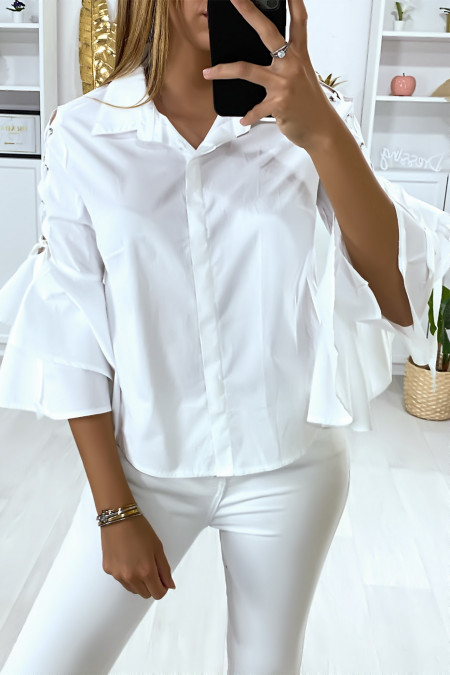 White shirt with ruffles on the sleeves and lace on the shoulders
