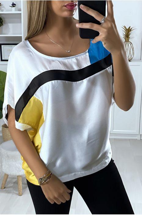 Losse blouse met verschillende veelkleurige stukken
