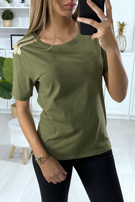Khaki T-shirt with gold embroidery on the shoulders