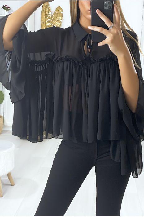 Blouse over size en noir avec volant et noeud au col