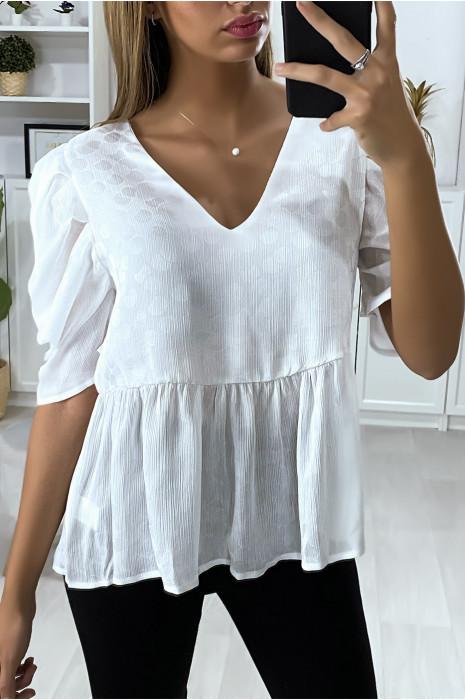 Soepelvallende witte blouse met reliëf en pofmouwen