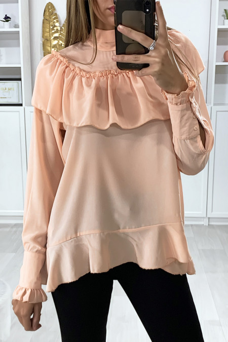 Pink blouse with ruffle and bow at the collar