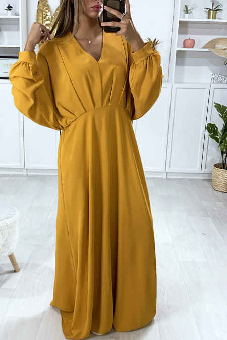 Long mustard bat sleeve dress with pleats at the waist