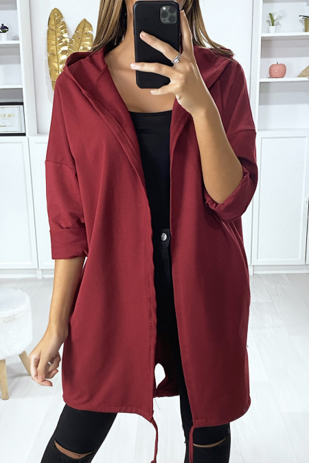 Burgundy cardigan with hood and pockets in brushed cotton with WHAT writing on the back
