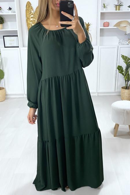 Lange groene wijd uitlopende jurk met ruche