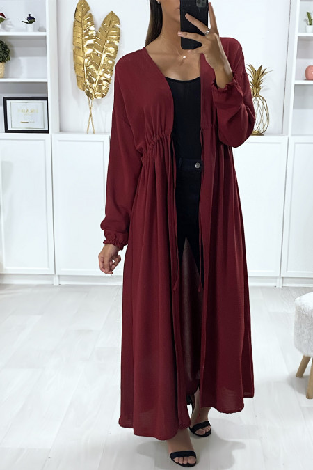 Long burgundy cardigan with long sleeves, adjustable at the waist