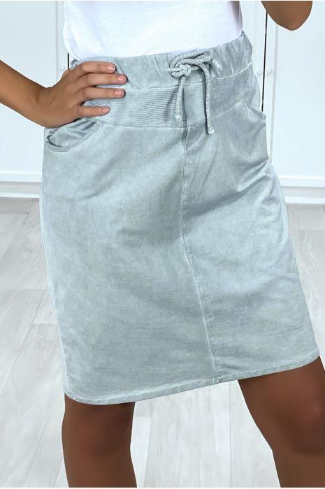 Zeer sportieve blauwe rok van verwassen katoen met zakken en kant