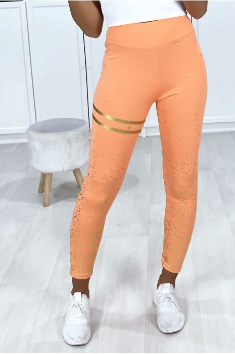 Oranje legging met gouden banden en stippen